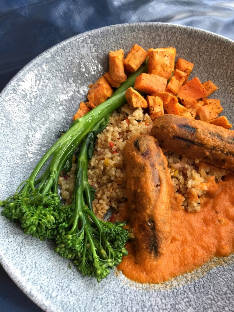 Vegan Protein Bowl Vegan Italian Sausage, Quinoa, Sweet Potatoes, and Broccolini with Roasted Cherry Tomato Sauce