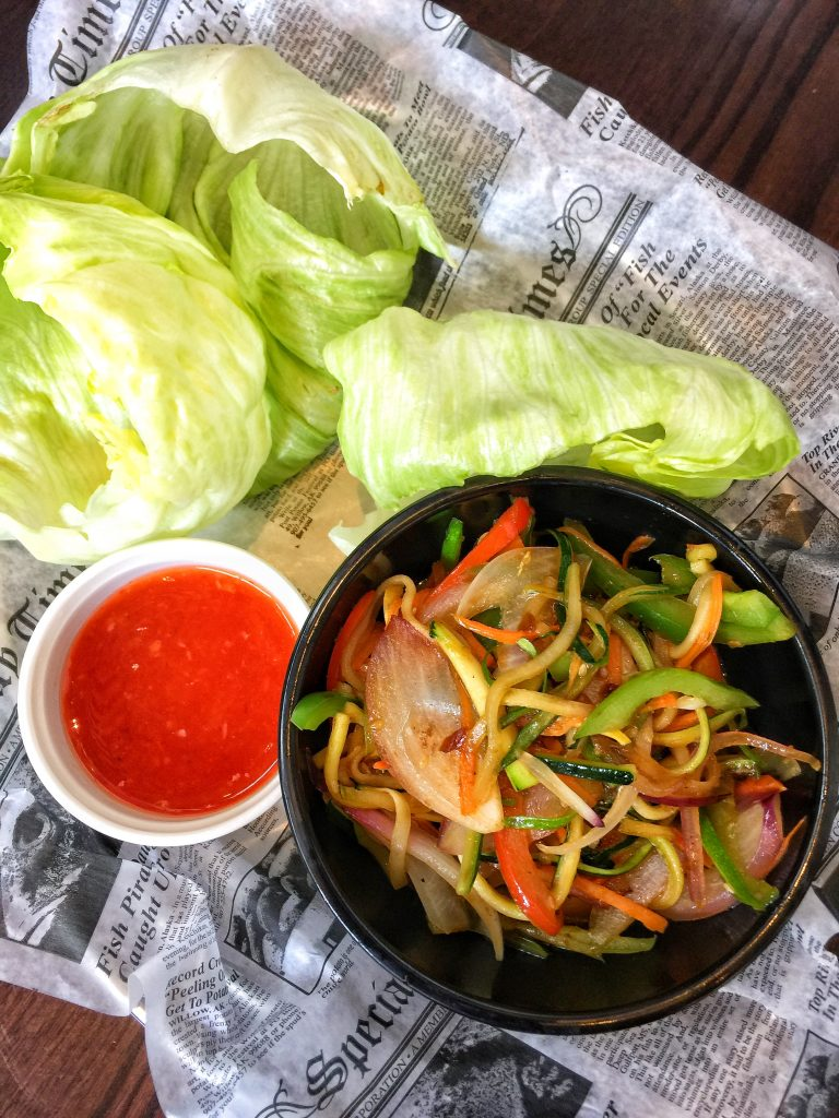 Veggie Lettuce Wraps Sautéed Peppers, Onions, Carrots, Squash, and Zucchini in Asian Sesame Marinade served with Iceberg Lettuce and crispy Wontons